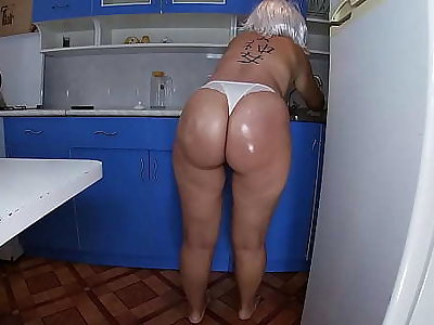 Matriarch washed the dishes in the kitchen and took the stepson's penis in her dish out and inserted it into her anal