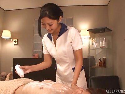 Kinky Asian masseur Mizuki Miri pleasures a stiff cum gun while topless