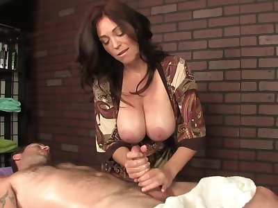 Hot masseuse with humongous boobs helps the client relax by a handjob