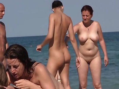 Nudist friens at the littoral