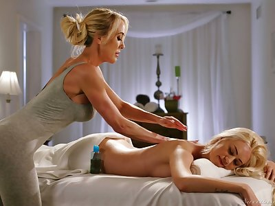 Matured lesbian masseuse Brandi Love gives a cunnilingus to young client