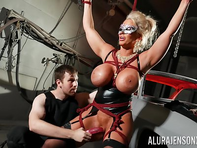 Bound blarney slut Alura Jenson is toyed with by a stranger in a dungeon